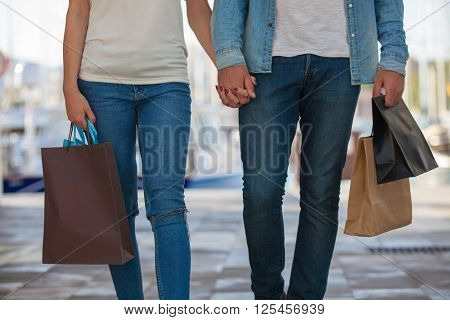 MAN AND WOMAN SHOPPING BAGS