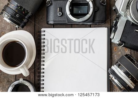 Old Cameras And Blank Paper On Wooden Table, Top View