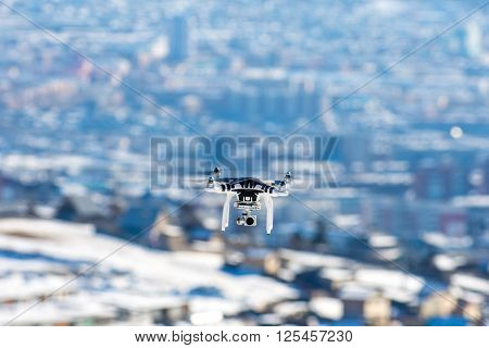 Ulan-Ude, Russia - March 5, 2016: Hovering drone that takes pictures of city sights