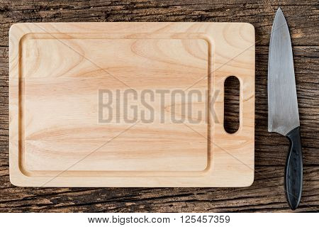 The Brown Wooden Cutting Board  On A Rustic Table Closeup,wooden Background.