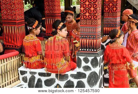 Group Of Young Girls In Traditional Clothes At Funeral Ceremony. Tana Toraja