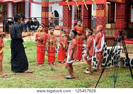 Group Of People In Traditional Clothes At Funeral Ceremony. Tana Toraja