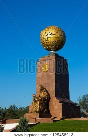 TASHKENT UZBEKISTAN - 2016 March 21: The Independence Monument with the globe and mother with child symbolizing Motherland