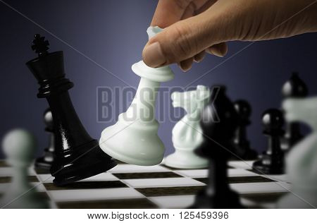 Chess game with King checkmate by Queen