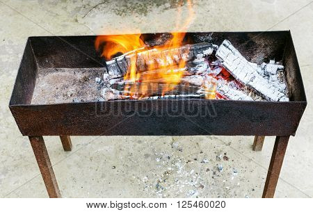 Outdoor Brazier With Burning Wood