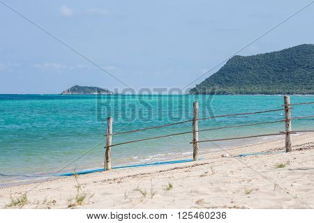 Wooden handmade fence on the beach for separating area