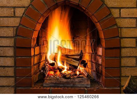 Tongues Of Fire In Indoor Brick Fireplace