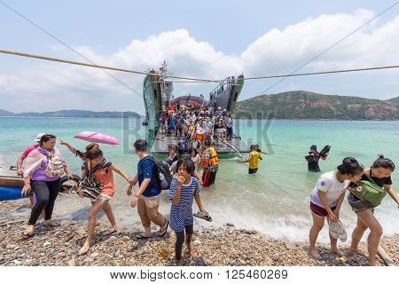 Chonburi Thailand - April 10 2016: People getting out from the boat to Kho Kham the popular island in Sattahip of Chonburi Thailand.