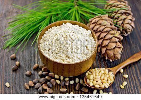 Flour Cedar In Wooden Bowl With Spoon On Board