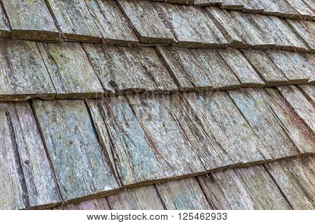 Old brown and grey wooden roof shingles