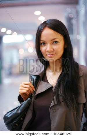Beautiful girl in a store