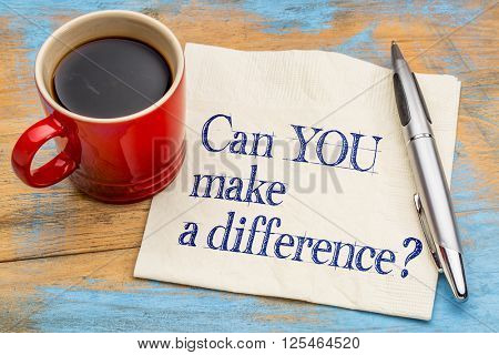 Can you make a difference? A motivational  question on a napkin with a cup of coffee