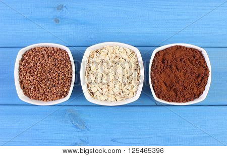Natural buckwheat oatmeal and powdery cocoa containing magnesium and dietary fiber healthy food and nutrition