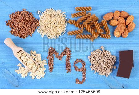 Inscription Mg ingredients and products containing magnesium and dietary fiber healthy nutrition wholemeal pasta sunflower buckwheat oatmeal brown rice linseed hazelnut chocolate
