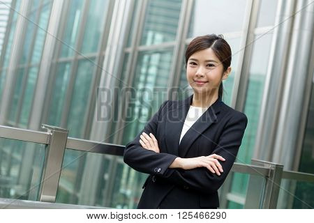 Businesswoman standing out of office