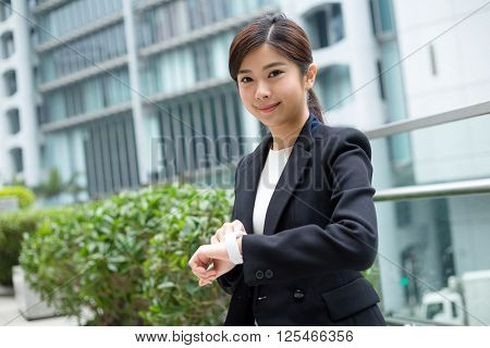 Business woman use of digital watch