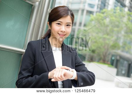 Young businesswoman use of smart watch