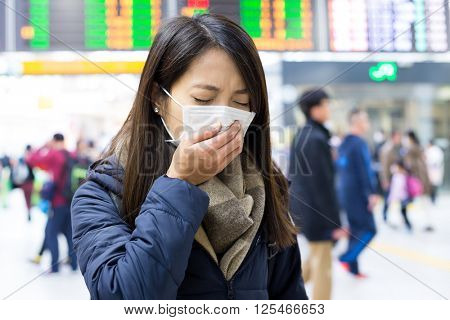 Woman feeling unwell at train station