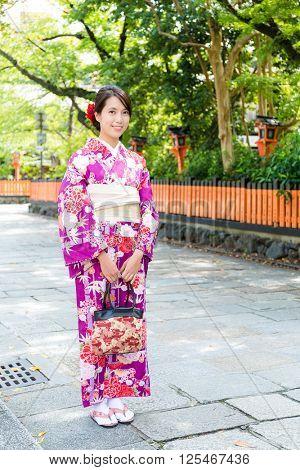 Young woman with kimono dressing