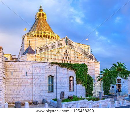 The view on the Basilica on Annunciation of Nazareth in evening lights Israel.