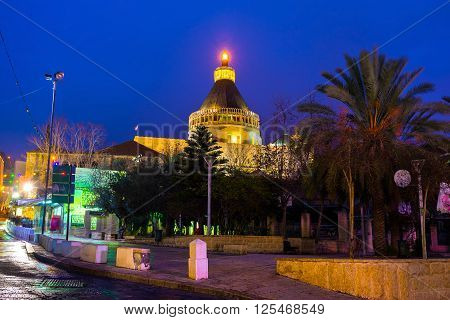 NAZARETH ISRAEL - FEBRUARY 21 2016: The beautiful illumination of the Basilica of Annunciation and El-Bishra street in the evening on February 21 in Nazareth.