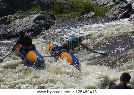 Beklenischevo, Russia - June 12, 2005: Water sportsmen in threshold