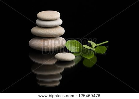 Balancing Zen Stones On Black