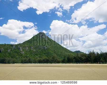 Beautiful landscape with mountain and green tree beside beach under blue sky at Khao Sam Roi Yot National Park in Thailand