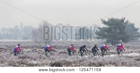 EPE THE NETHERLANDS - MARCH 5 2016: Cyclists under winter skies on a training ride in order to regain the fitness lost over the holidays.