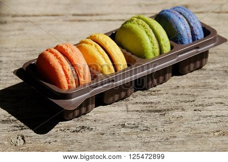 many colors ot macaron on the wood floor ** Note: Soft Focus at 100%, best at smaller sizes