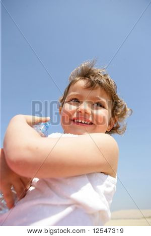 Portrait of a little girl smiling with a bottle of water