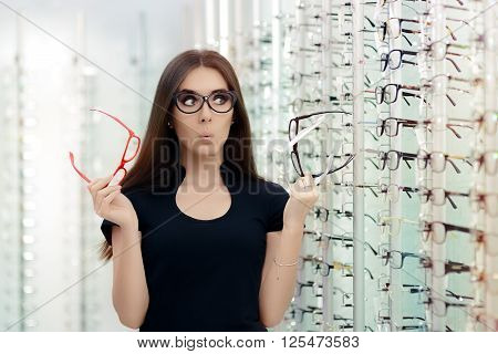 Woman Choosing Eyeglasses Frames in Optical Store - Cute girl deciding for glasses of different shapes and colors