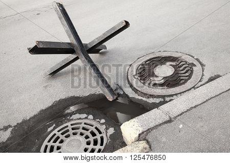 Black Steel Street Barrier On Asphalt Urban Road