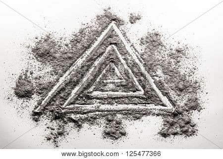 Triangle spiral shape drawing made in grey ash