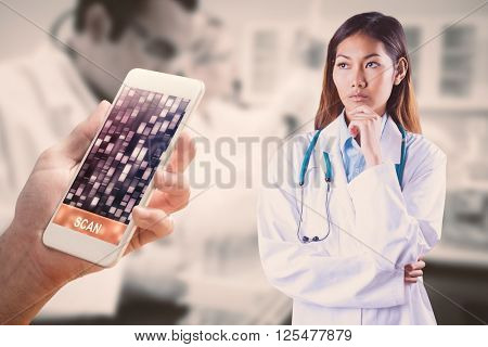 Focused asian woman thinking against yellow, red, orange dna strands