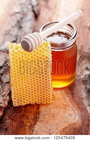 jar of honey with honey comb - food and drink