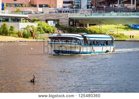Adelaide Australia - January 3 2016: Iconic Pop-Eye boat sailing along the River Torrens with people on board in Adelaide CBD Elder Park on a bright day