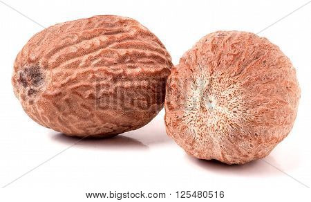 Two nutmeg whole  isolated on white background.