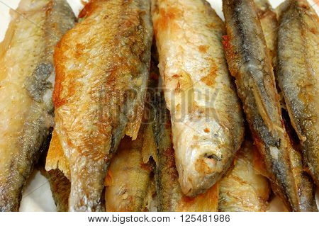 fried river fish with a golden crust. closeup