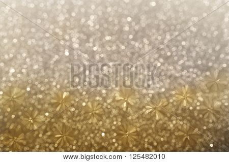 Lovely Glitter Shining Abstract Flower Shape On Mini Gold And Platinum Bokeh Background