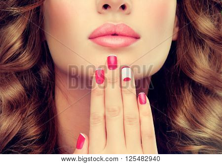 woman with red and white Moon French   manicure .  girl with red nail Polish on the nails . Makeup and cosmetics . Lunar manicure nail.