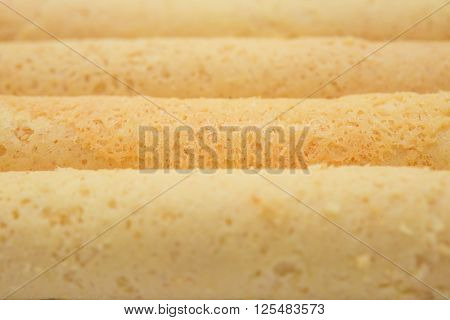 sweet egg rolls as background and texture