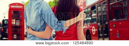 people, homosexuality, same-sex marriage, travel and gay love concept - close up of happy women couple hugging over london city background