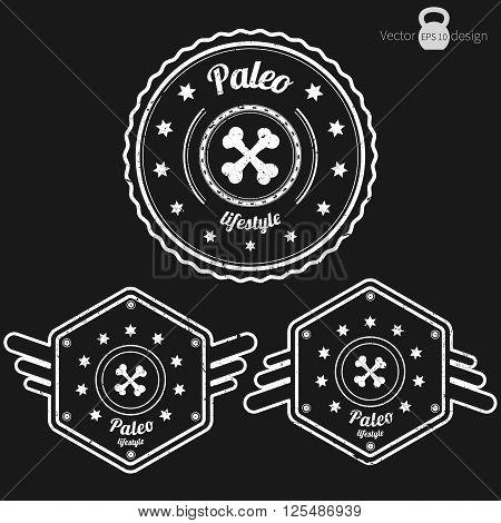 Vector set of three retro Paleo badges grunge style white color on dark background