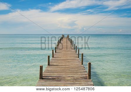 Summer Travel Vacation and Holiday concept - Wooden pier in Phuket Thailand