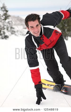 Portrait of a young man snowboarding