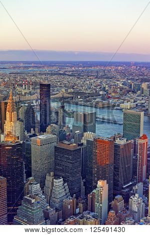 Aerial view from Observatory deck of the Empire State Building on Midtown district in Manhattan in New York. East river and New York Queensboro Bridge in Long Island City are on the background.