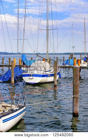 Pier with boats in Reichenau Island on Lake Constance. Reichenau is an island in Baden-Wurttemberg in Germany. It is under the UNESCO protection.