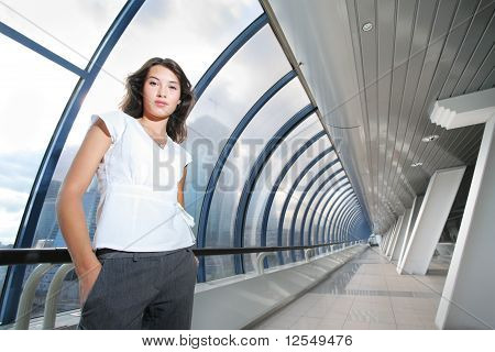 Confident Businesswoman In Futuristic Interior.