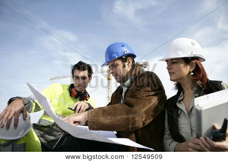 Portrait of three entrepreneurs on a construction site